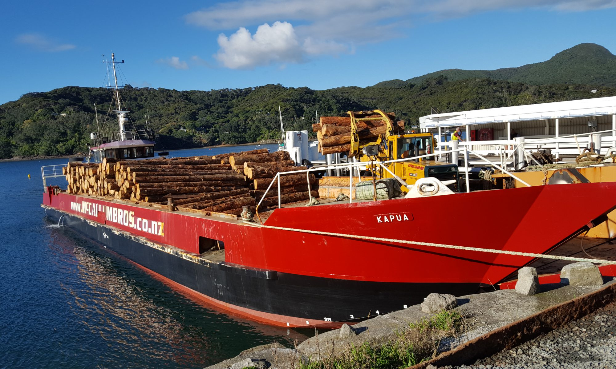 Kapua motorised barge contract transport of logs in Haurake Gulf